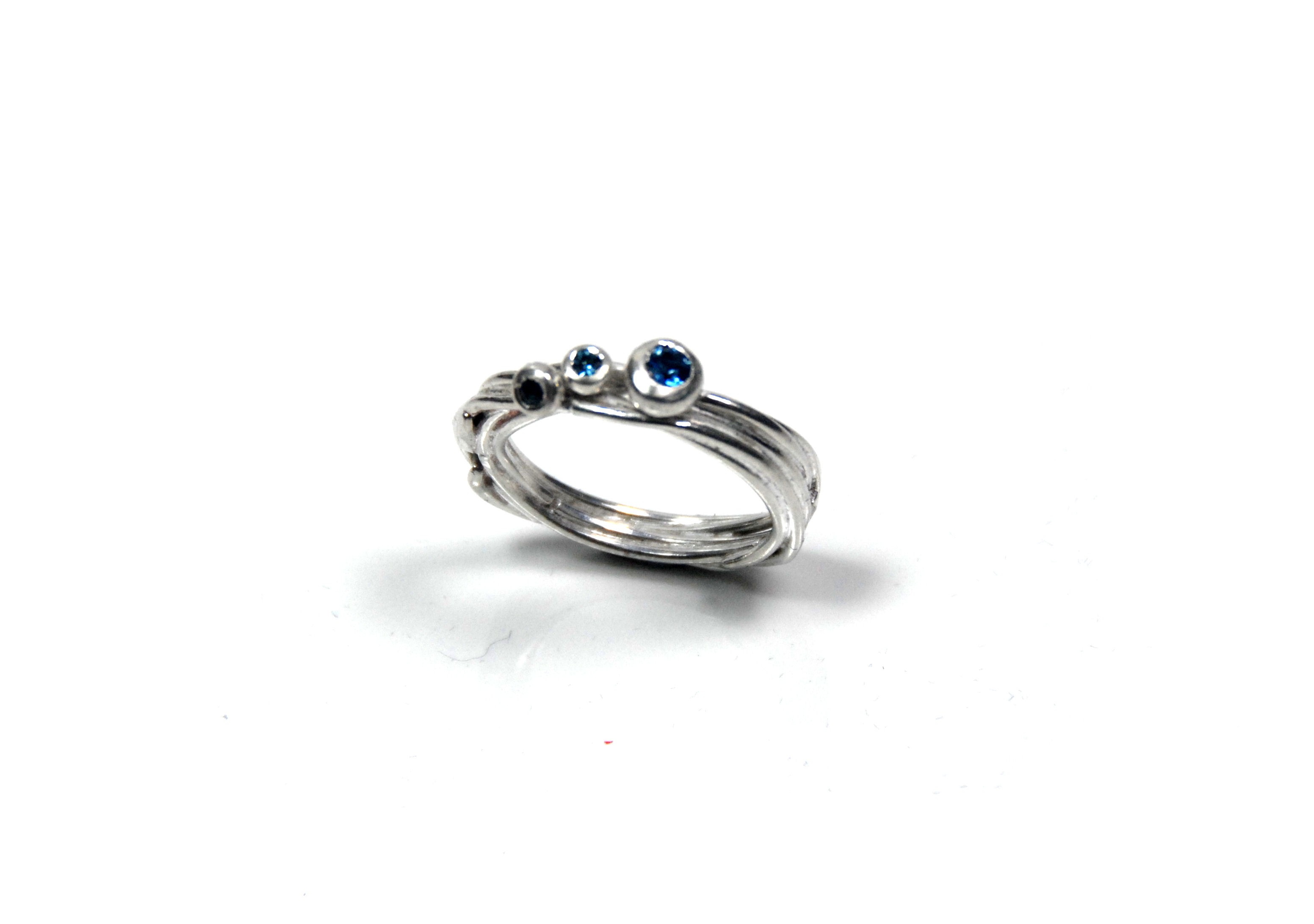 Flourish wrap ring blue topaz